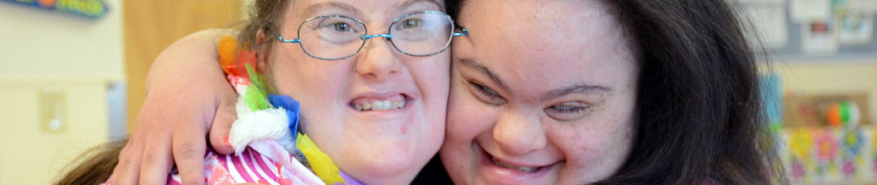 image of two women's smiling faces