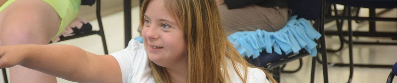 girl at camp smiling