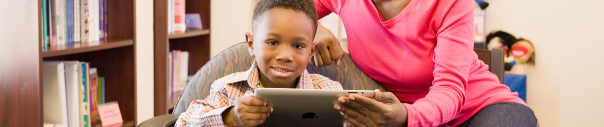 image of young boy reading